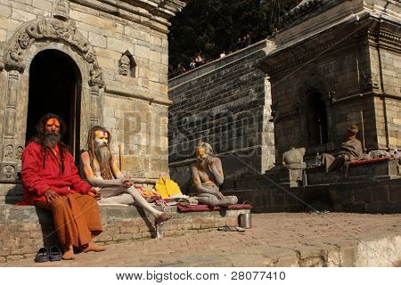 KATHMANDU, NEPAL - JANUARY 2: Sadhu (holy men) seeking alms in front of at Pashupatinath Temple on the banks of River Baghmati, January 2, 2009 in Kathmandu, Nepal.