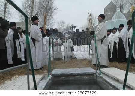 TOMSK, RUSSIA - JANUARY 19: Consecration ice-hole, celebration of Epiphany (Holy Baptism) in the Orthodox tradition, January 19, 2010 in Tomsk, Russia.