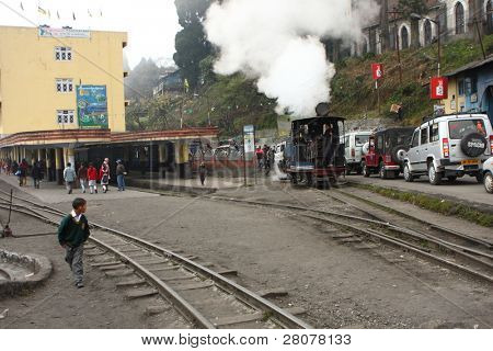"DARJEELING, INDIA - DECEMBER 3: The Darjeeling Himalayan Railway, nicknamed the ""Toy Train"", is a 2 ft (610 mm) narrow-gauge railway from Siliguri to Darjeeling, December 3, 2008 in Darjeeling, India."