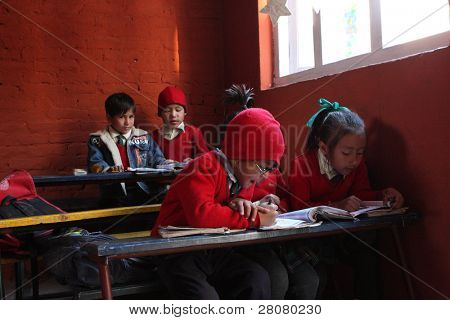"KATHMANDU, NEPAL - JANUARY 1: Pupil in learning session during lesson in small primary school ""Happy Home School"" in poor area of city, January 1, 2009 in Kathmandu, Nepal."