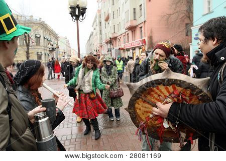 MOSCOW, RUSSIA - MARCH 21: On Arbat Street marking St. Patrick's Day, it has recently become a tradition in Moscow to mark the Irish holiday, March 21, 2010 in Moscow, Russia.