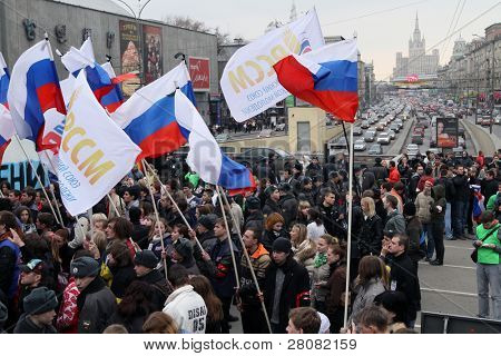 MOSCOW - MARCH 31: Youth hold flags during â??Generation Against Terrorâ? anti-terror demonstration at Triumphal Square on March 31, 2010 in Moscow.