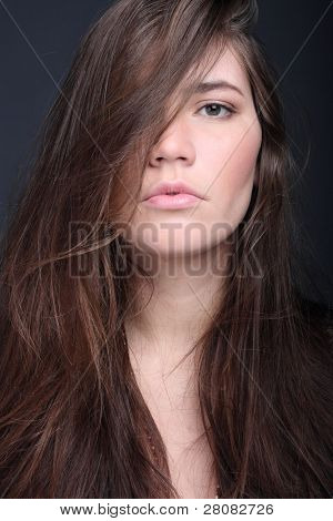 Portrait of haughty fashion woman with long hair
