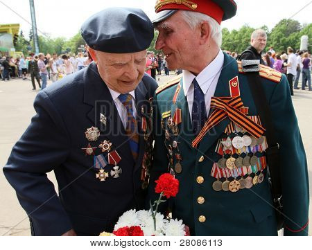 MOSCOW - MAY 9: Two veterans on Victory Day (65th anniversary) in the Great Patriotic War celebrations in Park Kultury, May 9, 2010 in Moscow, Russia.