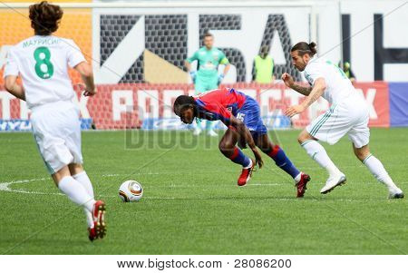 MOSCOW - MAY 10: CSKAs Chidi Odiah (C) in action during their teams Russian football championship game CSKA (Moscow) vs. Terek (Grozny) - (4:1), May 10, 2010 in Moscow, Russia.