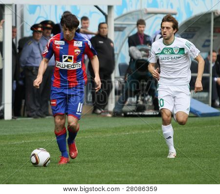 MOSCOW - MAY 10: CSKA's Alan Dzagoev (L) in action during their team's Russian football championship game CSKA (Moscow) vs. Terek (Grozny) - (4:1), May 10, 2010 in Moscow, Russia.