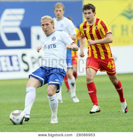 MOSCOW - MAY 15: Dinamo's Andrei Voronin (L) and Alania's Jury Kirillov (R) in a game - Dinamo Moscow vs. Alania Vladikavkaz - 2:0, May 15, 2010 in Moscow, Russia.