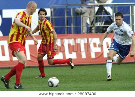 MOSCOW - MAY 15: Alania's midfielder George Floresku (C) and Dinamo's midfielder Igor Semshov (R) in a game Dinamo Moscow vs. Alania Vladikavkaz - 2:0, May 15, 2010 in Moscow, Russia.