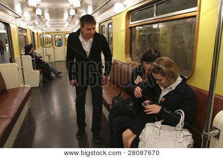 MOSCOW - MAY 15: Passengers of the vintage car, a replica of the first 1934 train, that set off along the Red line marking the 75th anniversary of the Moscow Metro, May 15, 2010 in Moscow, Russia.