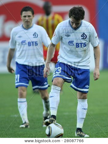 MOSCOW - MAY 15: Dinamo's midfielder Igor Semshov (L) and Dinamo's defender Luke Wilkshire (R) in a game Dinamo Moscow vs. Alania Vladikavkaz - 2:0, May 15, 2010 in Moscow, Russia.
