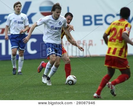 MOSCOW - MAY 15: Dinamo's defender Vladimir Granat (C) in a game of the 11th round of Russian Football Premier League - Dinamo Moscow vs. Alania Vladikavkaz - 2:0, May 15, 2010 in Moscow, Russia.