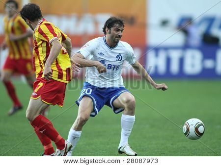 MOSCOW - MAY 15: Dinamo's midfielder Adrian Ropotan (R) in a game of the 11th round of Russian Football Premier League - Dinamo Moscow vs. Alania Vladikavkaz - 2:0, May 15, 2010 in Moscow, Russia.