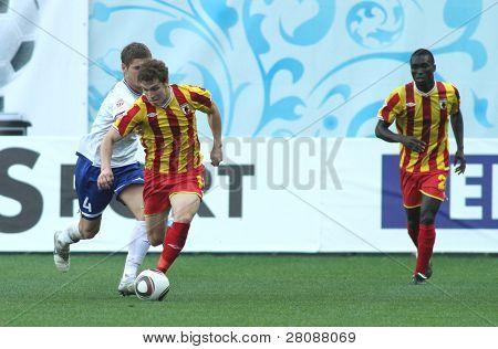 MOSCOW - MAY 15: Dinamo's defender Marcin Kowalczyk (L) and Alania's forward Aleksandr Marenich (C) in a game Dinamo Moscow vs. Alania Vladikavkaz - 2:0, May 15, 2010 in Moscow, Russia.