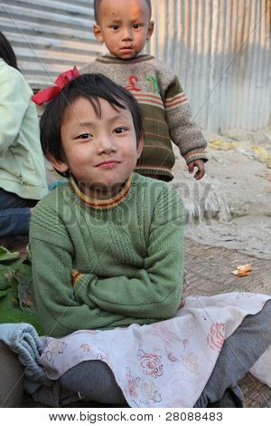 KATHMANDU, NEPAL - JANUARY 7: children  Di Lakshmi (front) and Vishnu Kumar of a poor area at Old Baneshwor near Bagmati river, January 7, 2009 in Kathmandu Nepal.