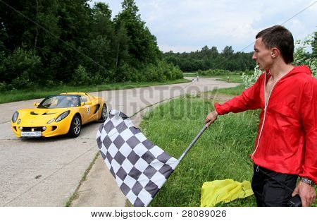 DMITROV, RUSSIA - JUNE 13: The finish line (Lotus Exige) at Championship 'Rus Hill climb Open' at avtopoligone NIITSAMT, June 13, 2010 in Dmitrov, Russia.