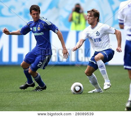 MOSCOW - JULY 3: Dynamo Kyiv's defender Danilo da Silva (L) and Dynamo Moscow's midfielder Dmitry Kombarov (R) in the game Dynamo Moscow vs. Dynamo Kyiv (2:0), July 3, 2010 in Moscow, Russia.