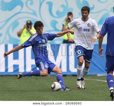 MOSCOW - JULY 3: Dynamo Kyiv's midfielder Roman Eremenko (L) and Dynamo Moscow midfielder Adrian Ropotan (20) in the game: FC Dynamo Moscow vs. FC Dynamo Kyiv (2:0), July 3, 2010 in Moscow, Russia.