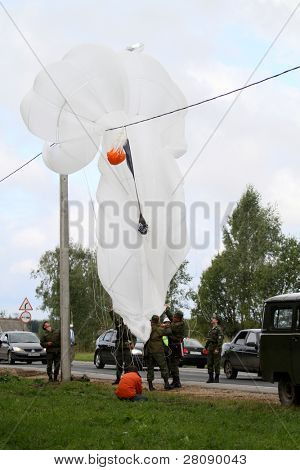 KOSTROMA REGION - AUGUST 26: Parachute landing of people and equipment on the Command post exercises with 98-th Guards Airborne Division, August 26, 2010 in Kostroma region, Russia.