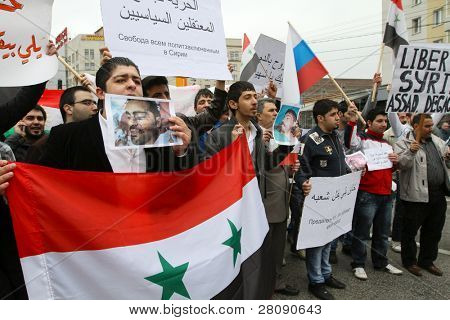 MOSCOW - MAY 1: Rally of representatives of Syrian community on Kaluzhskaya Square where communists gather before the Labor Day march in central Moscow, May 1, 2011 in Moscow, Russia.