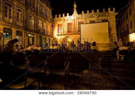 GUIMARAES, PORTUGAL - AUGUST 26: Cinema festival at night, main center of Guimaraes on Oliveira Square August 26, 2010 in Guimaraes, Portugal