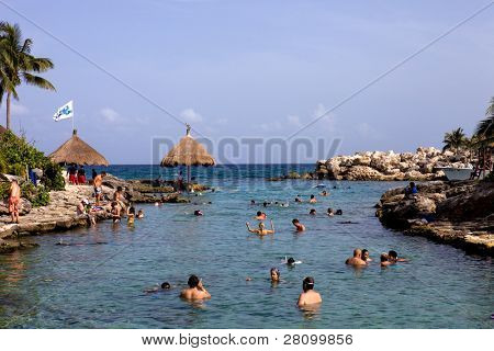 XCARET, MEXICO - AUGUST 12: People at the beach in Xcaret Park on August 12, 2010 in Xcaret, Yucatan, Mexico