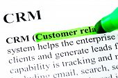 CRM customer relationship management definition highlighted by green marker on white paper backgroun