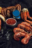 Set of fresh seafood: red and black caviar, limb of hairy crab, limb of snow crab, far eastern kamch poster