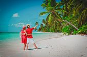 Young Happy Couple Making A Selfie On Beach poster