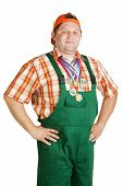 foto of roustabouts  - Confident working in overalls with a medal around his neck - JPG