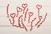 Red Fuzzy Wire Hearts And Ringlets On White Vintage Background poster
