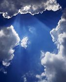 Cloud With A Halo Of Sunlight Against The Blue Sky. poster