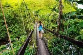 Young Woman Walking On Suspension Bridge Over Wainibau Stream, Lavena Coastal Walk, Taveuni Island,  poster