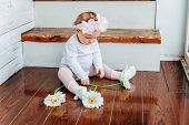 Little Smiling Baby Girl One Year Old Wearing Spring Wreath Siting On Floor In Bright Light Living R poster