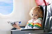 Child In Airplane. Kid In Air Plane Sitting In Window Seat. Flight Entertainment For Kids. Traveling poster