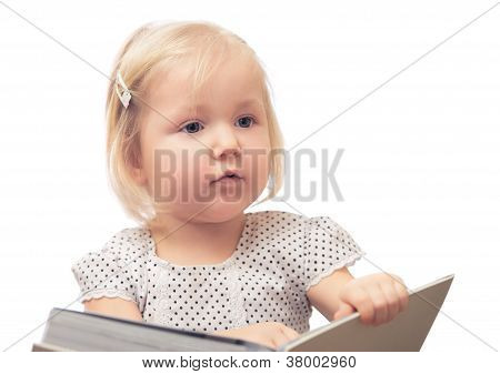Little girl reading a book. Isolated onwhite.
