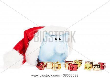 piggy bank wearing santas hat with tiny christmas presents