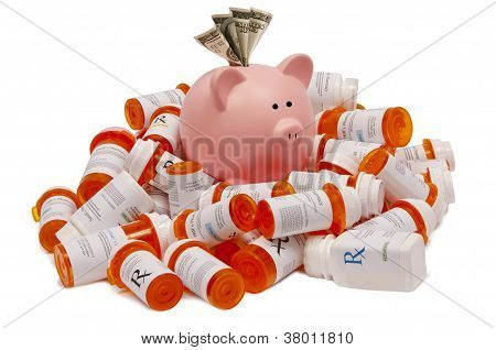 Pink Piggy Bank with Money Sitting Atop a Pile of Pill Bottles