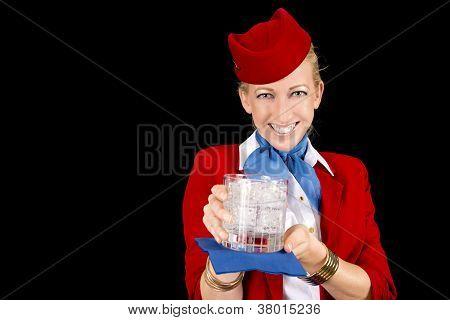 Flight Attendant Serving A Drink