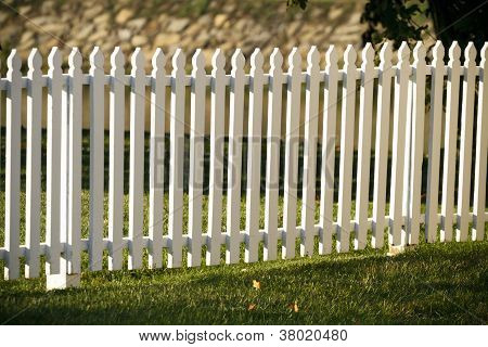 Wooden White Picket Fence At Sunset