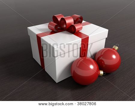 Gift box with christmas balls and a red ribbon