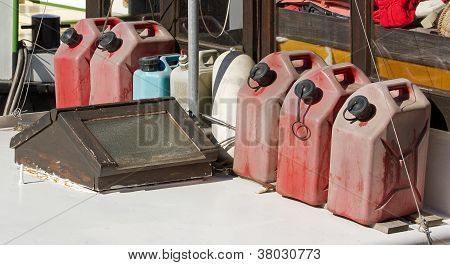 jerry cans of fuel, reserve on a boat