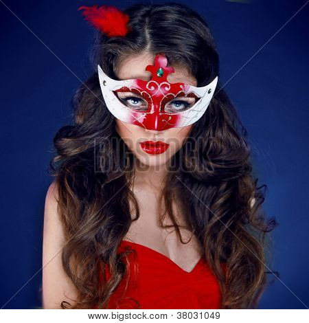 Masquerade. Beautiful Girl In Carnival Mask With Long Curly Hair