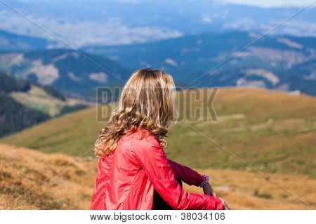 Hiker Woman Sitting On A Halt Halt In The Mountains
