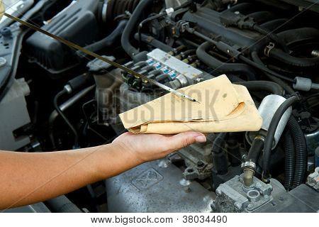 Auto Mechanic Checking Oil