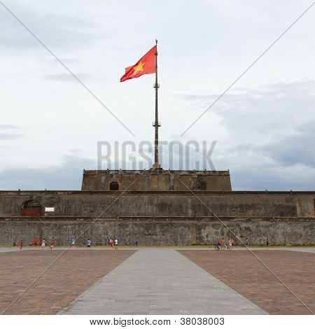 Hue, Vietnam - Aug 4: Boys Playing Football In Front Of The Flag Tower Ngo Mon Square In Hue Was One