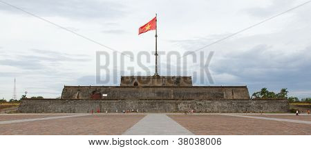 Hue, Vietnam - Aug 4: Unidentified Group Of Vietnamese Boys Playing Football In Front Of The Flag To