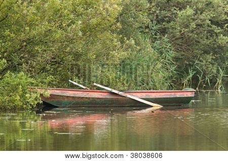 Red Rowing Boat On Lake