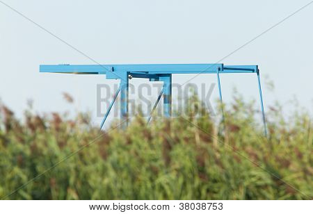 Blue Drawbridge Hidden In The Reeds