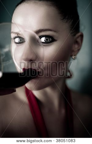 Beautiful Woman Drinking Red Wine