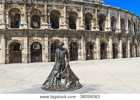 Nimeo Ii Statue And Roman Amphitheater In Nimes, France